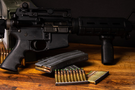 Photo pour Dark setting with an AR-15 with 5.56 ammunition and magazines - image libre de droit