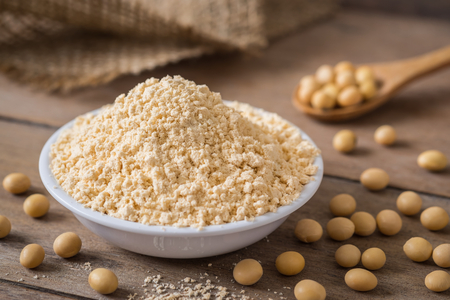 Photo for Soy flour in bowl and soybean - Royalty Free Image