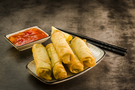 Photo for Spring rolls with vegetables, chopsticks and sweet and sour sauce - Royalty Free Image