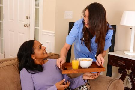 Foto de Home health care worker and an adult woman - Imagen libre de derechos