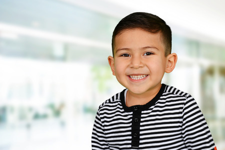 Photo for Young boy at school who is smiling - Royalty Free Image