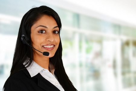 Photo pour Young woman giving help as a customer service employee - image libre de droit
