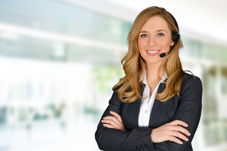 Foto per Young woman giving help as a customer service employee - Immagine Royalty Free