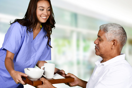 Foto per Health care worker helping an elderly man - Immagine Royalty Free