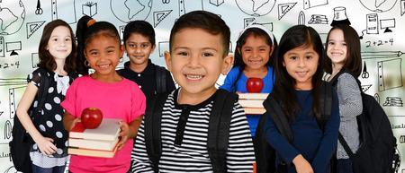 Foto de Young Children at school with their backpacks - Imagen libre de derechos