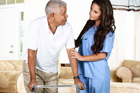 Photo for Health care worker helping an elderly man - Royalty Free Image