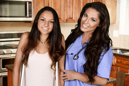 Foto per Home health care worker and a teenage girl - Immagine Royalty Free