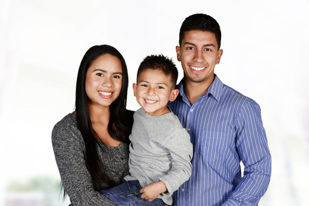 Foto de Young hispanic family who love being with each other - Imagen libre de derechos