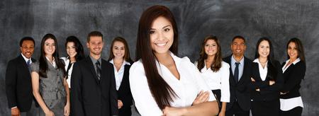 Foto de Group of businessmen and women working together - Imagen libre de derechos