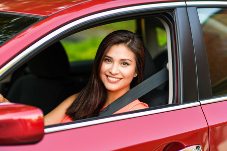 Photo for Woman holding up keys to her new car - Royalty Free Image