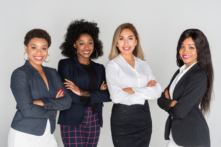 Photo pour Group of businesswomen working together in an office - image libre de droit