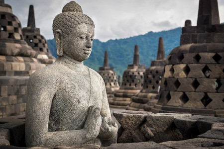 Photo for Ancient Buddha statue at Borobudur temple in Yogyakarta, Java, Indonesia. - Royalty Free Image