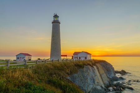 Photo pour Sunrise in the Cap-des-Rosiers Lighthouse, Gaspe Peninsula, Quebec, Canada - image libre de droit