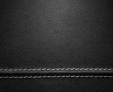 Real close-up of black leather background texture