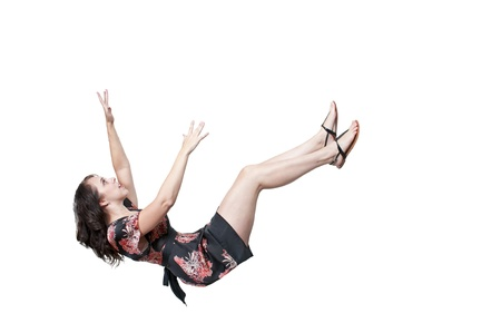 A beautiful young woman falling through the sky