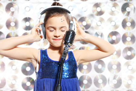 Photo for I love music  Child, teen, girl, singing into a microphone, a small singer - Royalty Free Image