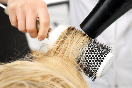 Foto de Drying hair on a round brush. - Imagen libre de derechos