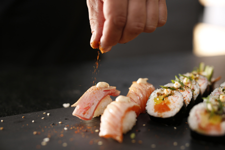 Classic Japanese sushi served on a stone plate
