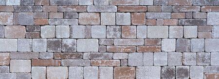 Photo pour Stone wall made of different square natural stones - image libre de droit