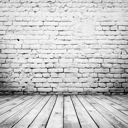 Foto de room interior vintage with white brick wall and wood floor background - Imagen libre de derechos