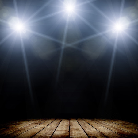 Photo for illustration of concert spot lighting over dark background and wood floor - Royalty Free Image