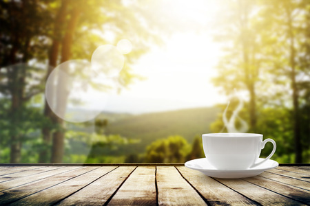 Foto für Cup with tea on table over mountains landscape with sunlight. Beauty nature background - Lizenzfreies Bild