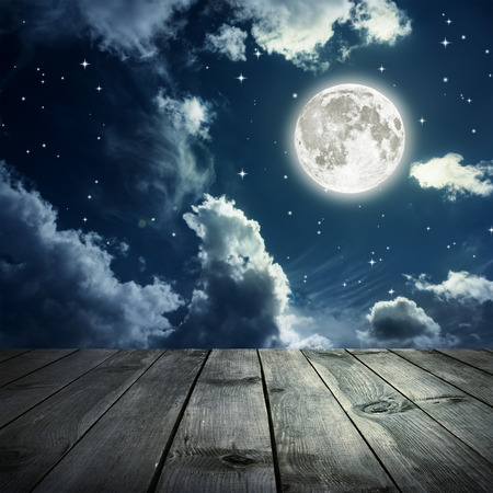 Photo pour Night sky with stars and full moon, wooden planks. - image libre de droit