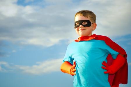 Foto per Child pretending to be a superhero - Immagine Royalty Free
