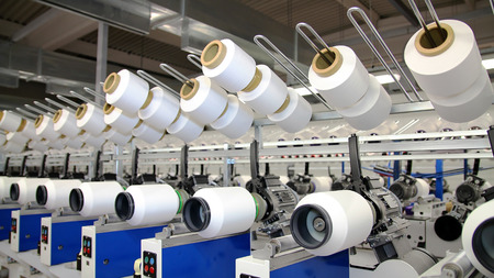 Photo pour Row of automated machines for yarn manufacturing. Modern Textile Plant. Textile manufacturing of synthetic fibers. - image libre de droit