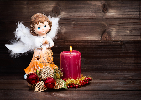 Photo for Christmas greeting card with candle and angels on wooden background. - Royalty Free Image