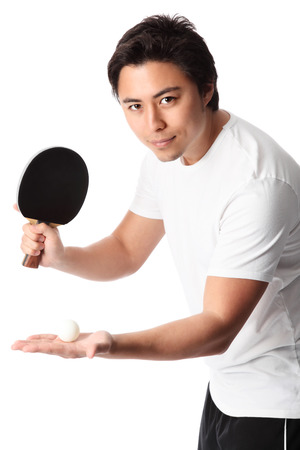 Young table tennis player wearing a white tshirt with black shorts