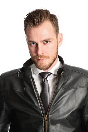 Photo for Attractive man wearing a white shirt black tie and a black leather jacket. White background. - Royalty Free Image