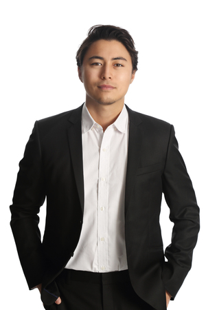 Foto de An attractive businessman wearing a black blazer with a white shirt, standing against a white background - Imagen libre de derechos