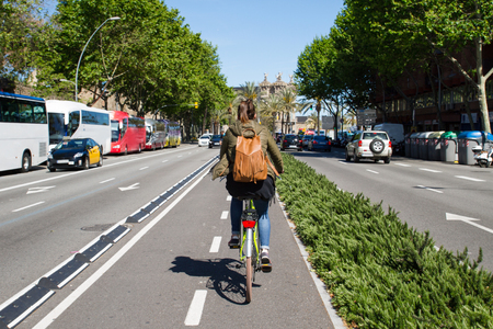 Photo for Riding a bike, bicycle in the city, wide angle image from behind - Royalty Free Image