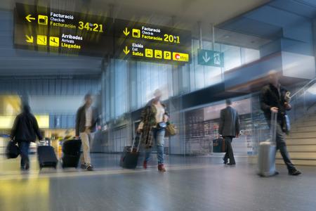 Photo pour Airline Passengers in an International Airport - image libre de droit