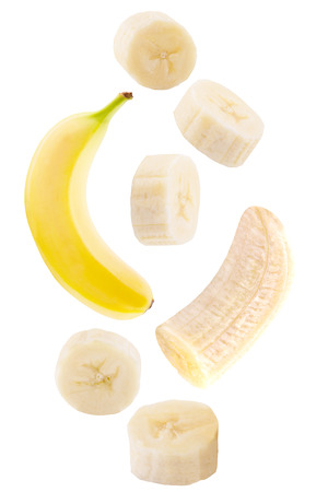 Foto de Isolated falling fruits. Falling banana fruit isolated on white background with clipping path as package design element. - Imagen libre de derechos