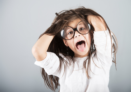 Photo for Funny crazy girl, studio shot, gray background - Royalty Free Image