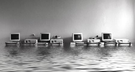 Photo pour Black and white photo cabinet with computers flooded with water - image libre de droit
