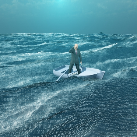 Foto de Man Adrift in tiny baot in binary ocean - Imagen libre de derechos