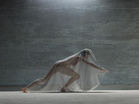 Foto de Action girl with transparent cloth - Imagen libre de derechos