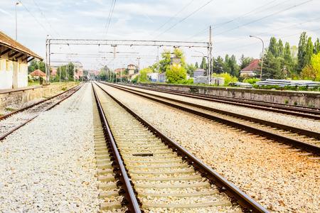 Rusty railroad track vanishing into the distance