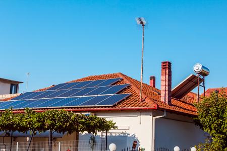 Foto de Solar cell panels are using renewable sun energy for making electricity, placed on house roof. Modern energy saving technology - Imagen libre de derechos
