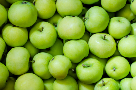 Foto per a lot of green apples as a background - Immagine Royalty Free
