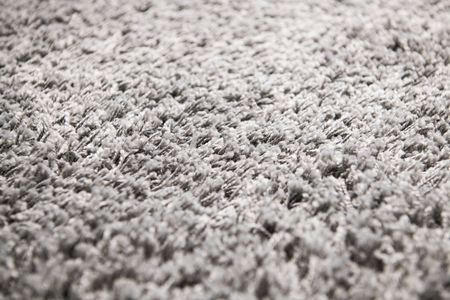 Foto de White carpet background texture, close up, gray textile texture, fluffy rug background, Wool fabric texture, beige hairy carpet, fragment shaggy mat, interior, material with pattern abstract. - Imagen libre de derechos
