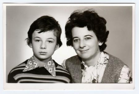 Photo pour BRNO, THE CZECHOSLOVAK SOCIALIST REPUBLIC, CIRCA 1980s: Retro photo of mother and her son. Portrait photo was taken in photo studio, circa 1980s. - image libre de droit