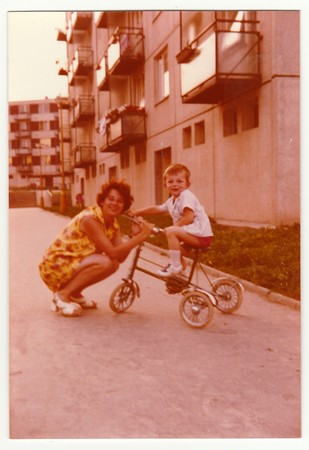 Foto de THE CZECHOSLOVAK SOCIALIST REPUBLIC, CIRCA 1974: Vintage photo shows mother with her son on tricycle, circa 1974. - Imagen libre de derechos
