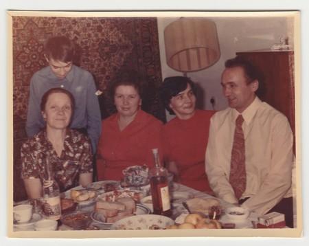 Foto de USSR - CIRCA 1970s: Vintage photo shows family during feast. - Imagen libre de derechos
