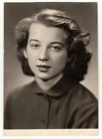 Photo pour THE CZECHOSLOVAK SOCIALIST REPUBLIC - CIRCA 1960s: Vintage photo of girl. Photo was taken in graduation time. - image libre de droit