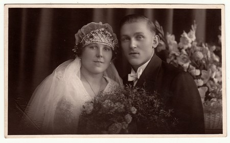Photo for CHRASTAVA (KRATZAU), THE CZECHOSLOVAK  REPUBLIC - CIRCA 1930s: Vintage photo of newlyweds. Bride wears a veil and diadem. Black & white antique studio portrait. - Royalty Free Image