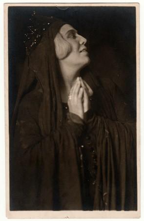 Foto de THE CZECHOSLOVAK SOCIALIST REPUBLIC - CIRCA 1960s: Vintage photo shows woman (actress) during theatre performance. Black & white antique photography. - Imagen libre de derechos